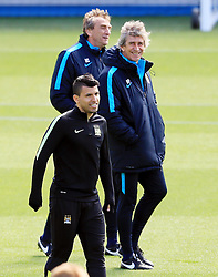Sergio Aguero of Manchester City and manager Manuel Pellegrini smile during training  - Mandatory byline: Matt McNulty/JMP - 25/04/2016 - FOOTBALL - City Football Academy - Manchester, England - Manchester City v Real Madrid - UEFA Champions League Training Session