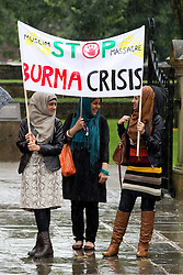 © Licensed to London News Pictures . 15/08/2012 . Manchester , UK . Demonstrators in support of Rohingya Muslim people living in southern Burma protest on Oxford Road, Manchester on August 15, 2012.  Members of Burma's Muslim Rohingya minority have been forced in to camps after houses in the  Burmese city of Sittwe  were razed to the ground in recent communal violence. Photo credit: Joel Goodman/LNP