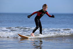 © Licensed to London News Pictures. 06/05/13 6 year old Oskar Davis gets a little surf practice in as people start to head to the beach in Tynemouth North East England to enjoy the bank holiday weather as a warm front sits over the country Photo credit : John Millard/LNP