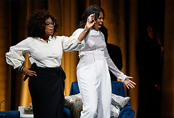 "Michelle Obama and Oprah Winfrey appear on stage to discuss the former first lady's book ""Becoming"" during the first stop of her book tour at the United Center Tuesday, November 13, 2018 in Chicago, IL, USA. Photo by Armando L. Sanchez/Chicago Tribune/TNS/ABACAPRESS.COM"