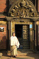 """The Golden Window or """"Golden Gate"""" as it is usually called is the main entrance to the Palace and Patan Museum. It is a masterpiece of repousse art. Inside the old palace, the Patan Museum has one of the world's best collections of Nepali art."""