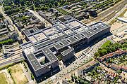 Nederland, Noord-Brabant, Gemeente Breda, 23-08-2016; OV Terminal Breda, het nieuwe centraal station van Breda. Combinatie van wonen, werken en reizen. Het dak van de stationshal, boven de perrons, bestaat uit een parkeerdak <br /> Public Transport Terminal Breda, the new central train station of Breda. Combination of living, working and traveling. The roof of the station, above the platforms, has been designed as car park<br /> luchtfoto (toeslag op standard tarieven);<br /> aerial photo (additional fee required);<br /> copyright foto/photo Siebe Swart