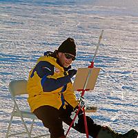 Famed Norwegian artist Vebjorn Sand paints near the Fenris Mountains.
