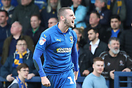 AFC Wimbledon midfielder Dylan Connolly (16) shouting during the EFL Sky Bet League 1 match between AFC Wimbledon and Gillingham at the Cherry Red Records Stadium, Kingston, England on 23 March 2019.