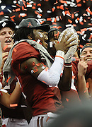 Daily Photo by Gary Cosby Jr.    ..Dre Kirkpatrick yells in triumph while holding the crystal football from the Coaches Trophy after Alabama defeated LSU 21-0 to claim their 14th National Championship...................................