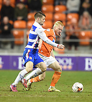 Blackpool's David Perkins battles with  Reading's Oliver Norwood<br /> <br /> Photographer Dave Howarth/CameraSport<br /> <br /> Football - The Football League Sky Bet Championship - Blackpool v Reading - Tuesday 7th April 2015 - Bloomfield Road - Blackpool<br /> <br /> © CameraSport - 43 Linden Ave. Countesthorpe. Leicester. England. LE8 5PG - Tel: +44 (0) 116 277 4147 - admin@camerasport.com - www.camerasport.com
