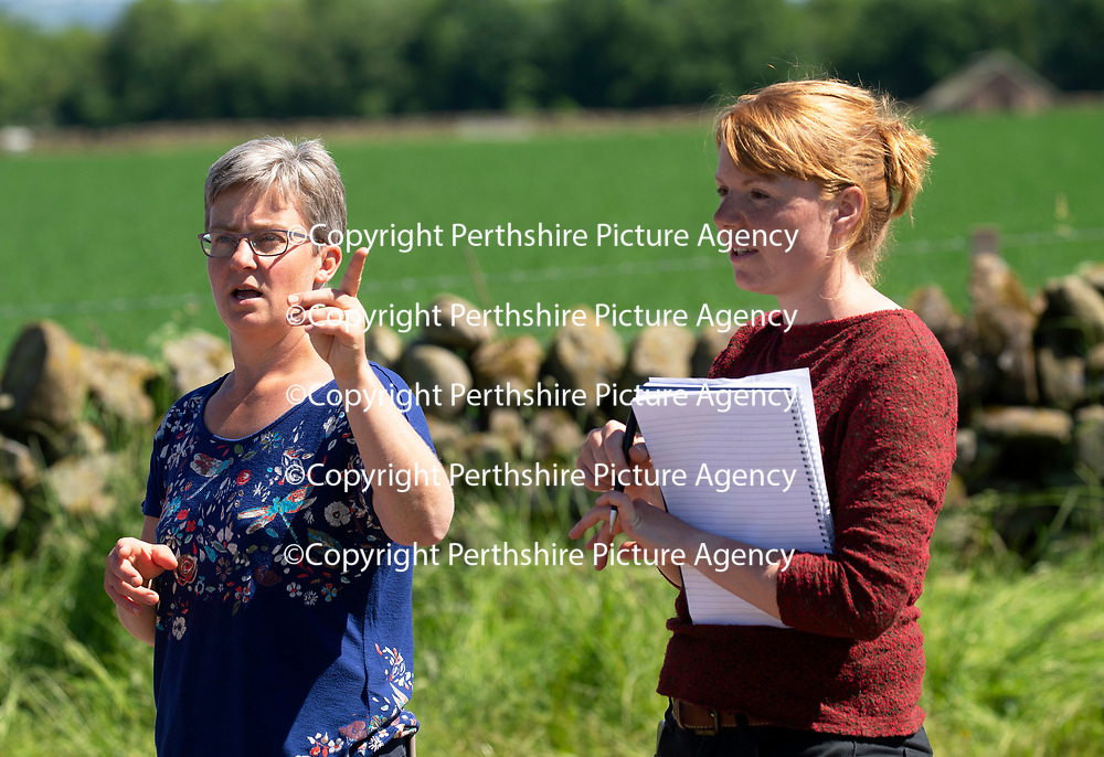Quality Meat Scotland (QMS) Better Grazing meeting at Newmiln Farm, Tibbermore, Perth<br />Emily Grant (left) from QMS pictured with Poppy Frater from SAC<br />Picture by Graeme Hart.<br />Copyright Perthshire Picture Agency<br />Tel: 01738 623350  Mobile: 07990 594431