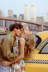 couple kissing in front of the World Trade Center in New York City