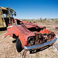 Crushed abandoned car in Mojave desert, California, USA