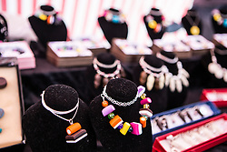 © Licensed to London News Pictures. 12/07/2015. Pontefract, UK. Picture shows Liquorice themed jewellery. Thousands of people have again turned out in Pontefract to celebrate all things Liquorice including sweets, beer, bread, pies, jam & jewellery . The town famed for the Pontefract cake has a 400 year history with Liquorice, it is believed Cluniac monks brought it to the area in the mid 1500 & introduced it as a medicine. Photo credit : Andrew McCaren/LNP