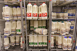 © licensed to London News Pictures. London, UK 22/07/2012. Milk being sold in a Morrisons supermarket today. The Morrisons supermarket chain announced that it will pay an additional 2p premium for each litre of milk it buys from farmers. Photo credit: Tolga Akmen/LNP