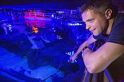 Matt feeding the sharks at Deep Sea World Loch Lomond.