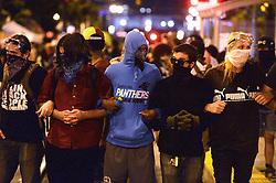 Protesters lock arms outside the police headquarters Sunday, September 25, 2016 in Charlotte, NC, USA. Protesters came together for the fifth straight night to protest following the fatal shooting of Keith Lamont Scott. Keith Lamont Scott was shot and killed by Charlotte-Mecklenburg Police Officer Brentley Vinson on Tuesday afternoon. Photo by Jeff Siner/Charlotte Observer/TNS/ABACAPRESS.COM