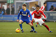 AFC Wimbledon midfielder Jake Reeves (8) shields the ball during the EFL Sky Bet League 1 match between AFC Wimbledon and Charlton Athletic at the Cherry Red Records Stadium, Kingston, England on 11 February 2017. Photo by Matthew Redman.