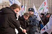 Moscow, Russia, 18/02/2006..Supporters of Belarussian President Alexander Lukasheno attack an anti Lukashenko demonstration outside the Russian Foreign Ministry.