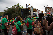 Sound systems parade through Kensal Road on Sunday on 28th August 2016 at Notting Hill Carnival in West London. A celebration of West Indian / Caribbean culture and Europes largest street party, festival and parade. Revellers come in their hundreds of thousands to have fun, dance, drink and let go in the brilliant atmosphere. It is led by members of the West Indian / Caribbean community, particularly the Trinidadian and Tobagonian British population, many of whom have lived in the area since the 1950s. The carnival has attracted up to 2 million people in the past and centres around a parade of floats, dancers and sound systems.