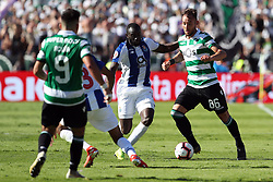 May 25, 2019 - Oeiras, Portugal - OEIRAS, PORTUGAL - MAY 25: Sporting's midfielder Nemanja Gudelj from Serbia (R ) vies with Porto's forward Moussa Marega from Mali (C ) during the Portugal Cup Final football match Sporting CP vs FC Porto at Jamor stadium, on May 25, 2019, in Oeiras, outskirts of Lisbon, Portugal. (Credit Image: © Pedro Fiuza/NurPhoto via ZUMA Press)