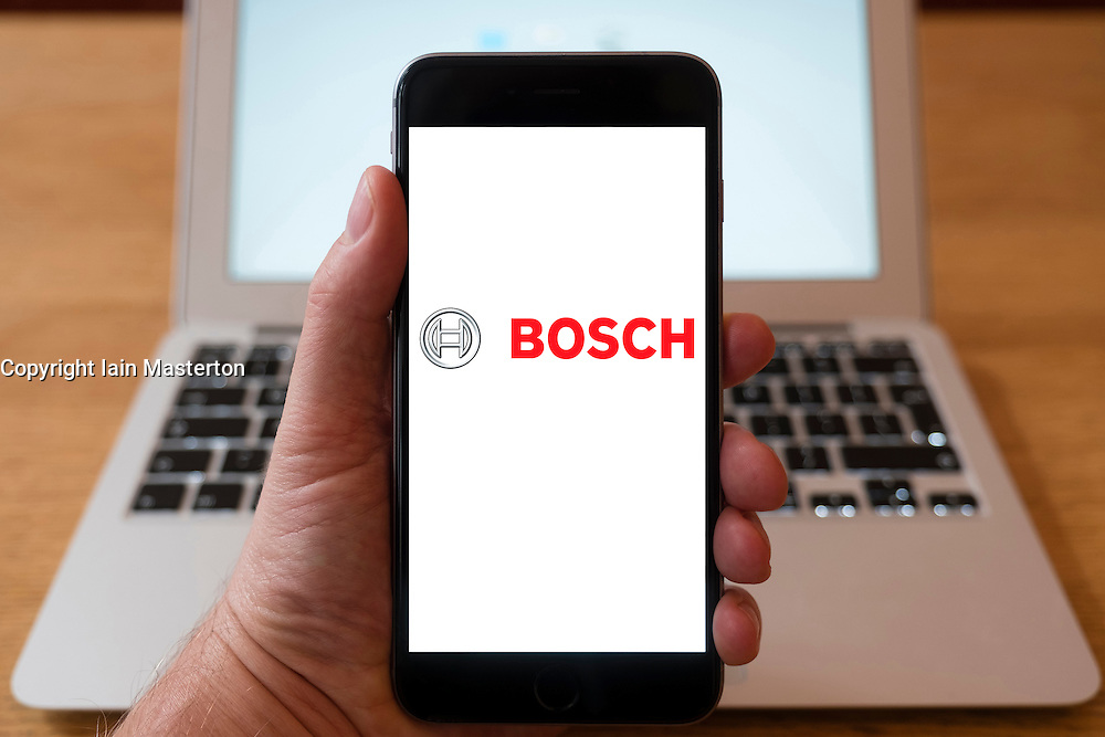 Using iPhone smartphone to display logo of Bosch industrial multinational