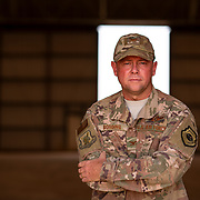 U.S. Air Force Col. Steven P. Bording, Commander of the 409th Expeditionary Group. Stands in one of the hangars built during his tenure, at Air Base 201 in Agadez, Niger, June 28, 2019. Col. Bording will soon relinquish command to Col. Jonathon M Creer. (U.S. Air Force photo by Tech. Sgt. Perry Aston)