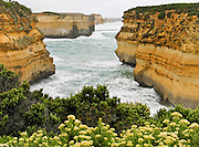 At Twelve Apostles Marine National Park, the Indian Ocean (or Southern Ocean according to Australian geographers) pounds and erodes soft miocene limestone bluffs of Port Campbell National Park, along the Great Ocean Road, Victoria, Australia. The Great Ocean Road (B100) is a 243-km highway along the southeast coast of Australia between Torquay and Warrnambool, in the state of Victoria. Dedicated to casualties of World War I, the Great Ocean Road was built by returned soldiers between 1919 and 1932 and is the world's largest war memorial.