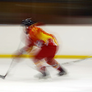 Zheng Canji, China is a blur of motion while in action during the China V New Zealand match during the 2012 IIHF Ice Hockey World Championships Division 3 held at Dunedin Ice Stadium. Dunedin, Otago, New Zealand. 21st January 2012. Photo Tim Clayton