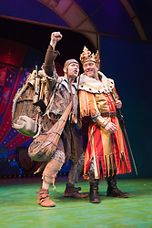 """© Licensed to London News Pictures. 26/07/2012. London, England. Jon Culshaw as King Arthur and Todd Carty as Patsy. Monty Python's """"Spamalot"""" musical based on the film """"Monty Python and the Holy Grail"""" opens at the Harold Pinter Theatre in London. The role of King Arthur is shared between Jon Culshaw and Marcus Brigstocke. Photo credit: Bettina Strenske/LNP"""