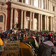 Tents and people in the square and on the steps. The London Stock Exchange was attempted occypied in solidarity with Occupy Wall in Street in New York and in protest againts the economic climate, blamed by many on the banks. Police managed to keep people away fro the Patornoster Sqaure and the Stcok Exchange and thousands of protestors stayid in St. Paul's Square, outside St Paul's Cathedral. Many camped getting ready to spend the night in the square.