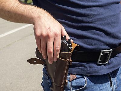May 16, 2015 - policeman put his hand on his holster with a gun (Credit Image: © Igor Golovniov/ZUMA Wire/ZUMAPRESS.com)