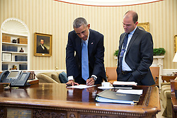 President Barack Obama confers with Ben Rhodes, Deputy National Security Advisor for Strategic Communications, in the Oval Office, Sept. 10, 2014. (Official White House Photo by Pete Souza)<br /> <br /> This official White House photograph is being made available only for publication by news organizations and/or for personal use printing by the subject(s) of the photograph. The photograph may not be manipulated in any way and may not be used in commercial or political materials, advertisements, emails, products, promotions that in any way suggests approval or endorsement of the President, the First Family, or the White House.