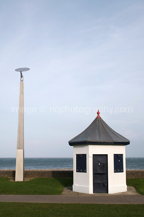 Victorian kiosk beside modern lamp post on the seafront in wintertime at the seaside town of Bray in Wicklow Ireland