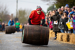 © Licensed to London News Pictures. 26/12/2019. Grantchester, UK. The annual Boxing Day barrel rolling relay race in Grantchester, Cambridgeshire. Four teams from local pubs compete to roll the empty barrels as rapidly as possible up and down the main road with the fastest time winning. Photo credit: Rob Pinney/LNP