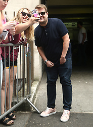 James Corden taking a selfie with fans during filming for The Late Late Show, at Methodist Central Hall, London.
