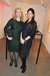 Left to right, The Ambassador of Lebonon to the UK INAAM OSSEIRAN and her daughter TALA OSSEIRAN at a private view of jewellery by Eugenie Nairchos and Noor Fares entitled Galactic Garden held at Shizaru Mayfair, 112 Mount Street, London on 5th December 2012.
