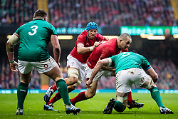 Ken Owens of Wales is tackled by James Ryan of Ireland<br /> <br /> Photographer Simon King/Replay Images<br /> <br /> Six Nations Round 5 - Wales v Ireland - Saturday 16th March 2019 - Principality Stadium - Cardiff<br /> <br /> World Copyright © Replay Images . All rights reserved. info@replayimages.co.uk - http://replayimages.co.uk