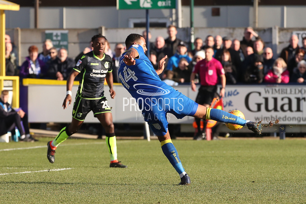 AFC Wimbledon midfielder Liam Trotter (14) with shot on goal during the EFL Sky Bet League 1 match between AFC Wimbledon and Bristol Rovers at the Cherry Red Records Stadium, Kingston, England on 17 February 2018. Picture by Matthew Redman.
