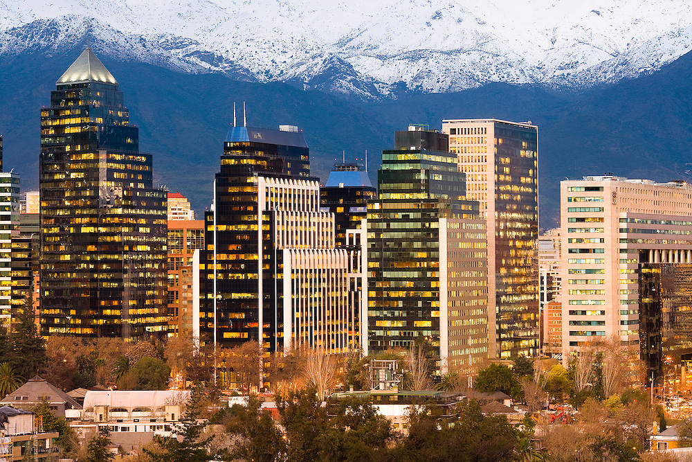 Skyline of modern office buildings at Las Condes and Providencia districts with snowed Andes mountain Range in the back, Santiago, Chile, South America <br /> <br /> For LICENSING and DOWNLOADING this image follow this link: http://www.masterfile.com/em/search/?keyword=700-03075642&affiliate_id=01242CH84GH28J12OOY4<br /> <br /> For BUYING A PRINT of this image press the ADD TO CART button.<br /> <br /> Download of this image is not available at this site, please follow the link above.