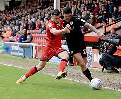 Walsall's Zeli Ismail and Barnsley's Alex Mowatt battle for the ball.