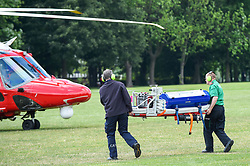 © Licensed to London News Pictures. 03/07/2019. LONDON, UK.  Medical equipment is removed from a Children's Acute Transport Service (CATS) ambulance on behalf of nearby Great Ormond Street Hospital and transferred to a Coastguard Rescue helicopter which is waiting to take off from Regent's Park.  The helicopter will make the journey to collect a sick child who will be brought back for treatment at Great Ormond Street as travel by road would take too long.  Photo credit: Stephen Chung/LNP