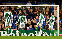 Photo: Daniel Hambury.<br />Chelsea v Real Betis. UEFA Champions League.<br />19/10/2005.<br />Betis' keeper Antonio Doblas is a moment away from dropping the ball at the feet of Ricardo Carvalho who taps in for Chelsea's second goal.