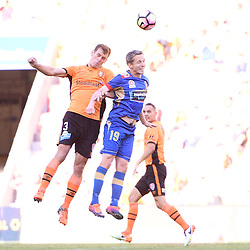 BRISBANE, AUSTRALIA - JANUARY 7: Luke DeVere of the Roar and Morten Nordstrand of the Jets compete for the ball during the round 14 Hyundai A-League match between the Brisbane Roar and Newcastle Jets at Suncorp Stadium on January 7, 2017 in Brisbane, Australia. (Photo by Patrick Kearney/Brisbane Roar)
