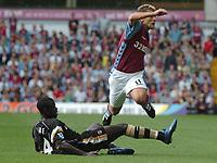 Photo: Ian Hebden.<br />Aston Villa v Charlton Athletic. The Barclays Premiership. 23/09/2006.<br />Villa's Stiliyan Petrov (R) is fouled by Charlton's Amady Faye (L).