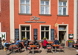 Cafe in front of traditional Dutch style house in Dutch Quarter in Potsdam Brandenburg Germany