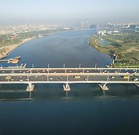 Aerial view of car traffic on a bridge crossing the Dubai creek, U.A.E.