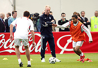 Photo: Chris Ratcliffe.<br />England training session. 06/06/2006.<br />Sven Goran Eriksson watches on as Aaron Lennon comes forward.