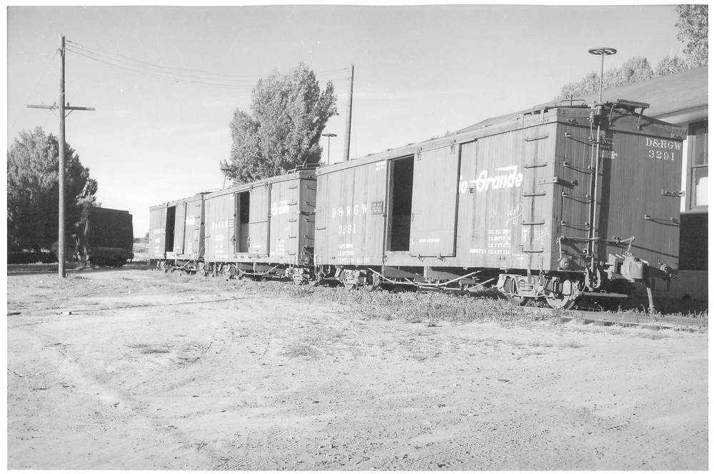 3/4 view of box cars #3291, 3486 & 3855.<br /> D&RGW