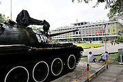 Replica of the Russian-designed T-54 tank no. 843 of the North Vietnamese Army 203rd Armoured Regiment, which on 30 April 1975 went crashing through the gates of the South Vietnamese presidential palace (in background), signalling the end of the war. Australian combat photographer Neil Davis famously captured that moment on film..Up until the end of the war the palace was called the Independence Palace--after Saigon fell, it was renamed the Reunification Palace..Ho Chi Minh City (Saigon), Vietnam