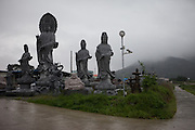 Buddha statues for sale at a highway close to the the city of Gwangyang. South Korea, Republic of Korea, KOR, 23nd of May 2010.