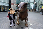 As numbers of Covid-19 cases in Birmingham have dramatically risen in the past week, increased lockdown measures have been announced for Birmingham and other areas of the West Midlands, people interact with Bully the Bull Ring bull in the city centre on 12th September 2020 in Birmingham, United Kingdom. With the rule of six also being implemented the Birmingham area has now be escalated to an area of national intervention, with a ban on people socialising with people outside their own household, unless they are from the same support bubble.
