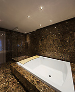 Elegant and spacious marble bathroom in a modern apartment. Nobody inside
