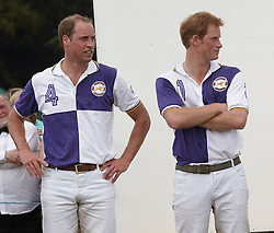 (L-R) Picture shows: Prince WIlliam and Prince Harry at the presentations after playing polo at Cirencester Park. Prince William and Prince Harry.<br />